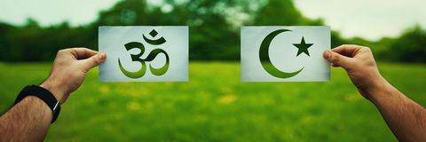 Islam vs Hinduism stock images