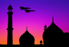 Islam war. Illustration showing a mosque with minaret and two fighters outlined on colored sunset background Stock Photos
