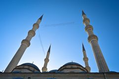 Mosque minaret and blue sky. Dome, design. Islam, which has the characteristics of a piece of Ottoman architecture stock images