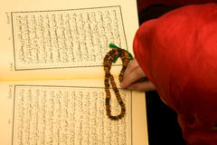 Islam woman. Islam muslim woman reading Quran stock photo