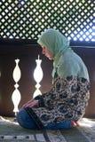 Islam woman prayer stock photo