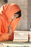 Islam, Woman Reading Qur'an stock images