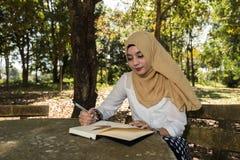 Islam woman write diary Stock Photos