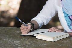Islam woman write diary Royalty Free Stock Photography