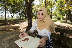 Islam woman write diary Stock Photography