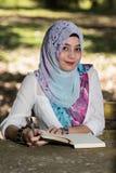 Islam woman write diary Stock Photo