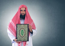 Islamic Arabian Shiekh presenting Quran Royalty Free Stock Photo
