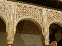 Islamic arch design at the Nazarene Palaces, Alhambra, Granada. Islamic arch design in the Alhambra, Granada Royalty Free Stock Images