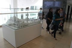 Tourist visit model of Sheikh Zayed Grand Mosque in Islamic Art Musium stock photography