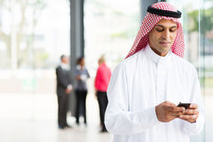 Islamic businessman smart phone Royalty Free Stock Image