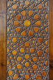 Islamic carvings on wooden surface Stock Photography