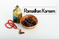 An islamic concept for Ramadhan. Flat lay composition of Qoran, Dates and a tasbih rosary beads on top of a sajadah praying