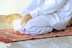 Islamic culture. Religious muslim man praying inside the Prayer stock image