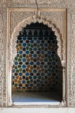 Islamic decoration. Carved islamic wall decoration filled with colourful tiles stock photography