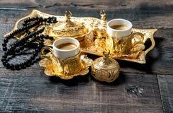 Islamic holidays coffee cups rosary beads Stock Photography
