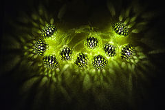 Islamic holidays decoration. Ramadan kareem. Glowing green light. Islamic holidays decoration. Ramadan kareem. Eid mubarak. Glowing green lights garland on dark
