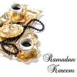 Islamic Holidays Golden coffee cups rosary white background Royalty Free Stock Image