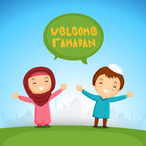 Islamic kids welcoming Ramadan Kareem. Cute Islamic kids welcoming Holy Fasting Month of Muslim Community, Ramadan Kareem in front of Mosque silhouette Royalty Free Stock Photos