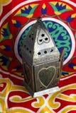 Islamic lantern. On Egyptian decorations fabric (khyamia fabrics Royalty Free Stock Images