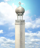 Islamic Minaret. A mosque minaret with a cupola dome and an islamic crescent moon and star on a blue sky background Royalty Free Stock Image