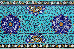 Islamic mosaic with blue tiles. Blue floral mosaic inside an old mosque in Yazd, Iran Royalty Free Stock Photo