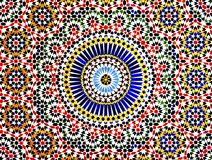 Islamic Mosaic, Morocco. The colorful and intricate geometric patterns of an Islamic mosaic decorate the walls of a kasbah in the Atlas Mountains of Morocco Royalty Free Stock Photography