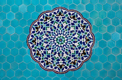 Islamic mosaic pattern with blue tiles. Blue arabesque design inside an old mosque in Yazd, Iran royalty free stock photography