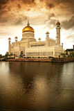 Islamic Mosque. Over the water with golden clouds stock photos