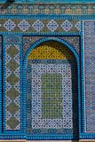 Islamic pattern, tile mosaic on mosque. Colorful Islamic patterns, window covered with Arabic  screen, mosaic tiles. Dome of the Rock, Temple Mount mosque Stock Photo