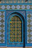 Islamic pattern, tile mosaic on mosque. Colorful Islamic patterns, window covered with Arabic  screen, mosaic tiles. Dome of the Rock, Temple Mount mosque Royalty Free Stock Photos