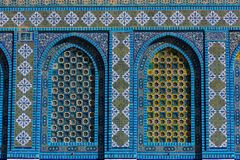 Islamic pattern, tile mosaic on mosque. Colorful Islamic patterns, window covered with Arabic  screen, mosaic tiles. Dome of the Rock, Temple Mount mosque Stock Images