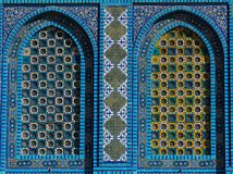 Islamic pattern, tile mosaic on mosque. Colorful Islamic patterns, window covered with Arabic  screen, mosaic tiles. Dome of the Rock, Temple Mount mosque Stock Photos