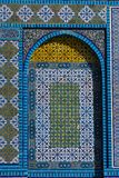 Islamic pattern, tile mosaic on mosque. Colorful Islamic patterns, window covered with Arabic  screen, mosaic tiles. Dome of the Rock, Temple Mount mosque Royalty Free Stock Images
