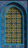 Islamic pattern, tile mosaic on mosque. Colorful Islamic patterns, window covered with Arabic  screen, mosaic tiles. Dome of the Rock, Temple Mount mosque Royalty Free Stock Image