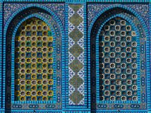 Islamic pattern, tile mosaic on mosque. Colorful Islamic patterns, window covered with Arabic  screen, mosaic tiles. Dome of the Rock, Temple Mount mosque Royalty Free Stock Photography