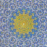 Islamic Persian Motif on Blue Tiles of a Mosque. Arabesque design inside dome of an ancient mosque, situated in Chahar Bagh of Isfahan, Iran Royalty Free Stock Image