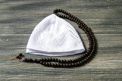 Islamic prayer hat and robe, prayer rug used in prayer, prayer to make skull, Islamic figures and symbols, Islamic values, Stock Image