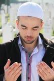 Islamic praying on dead person Stock Photos