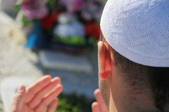 Islamic praying on dead person Stock Image