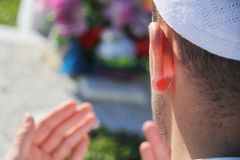 Islamic praying on dead person Royalty Free Stock Photo