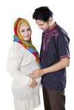 Islamic pregnant couple in studio Royalty Free Stock Photography