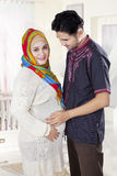 Islamic pregnant woman and her husband Royalty Free Stock Image