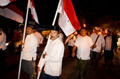 Islamic religious holiday. Muslims carry the torch while celebrating a religious holiday in the city of Solo, Central Java, Indonesia stock image