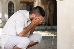 Islamic Religious Rite Ceremony Of Ablution Face Washing Stock Photos