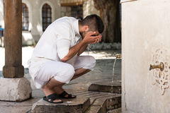 Islamic Religious Rite Ceremony Of Ablution Face Washing Stock Photo
