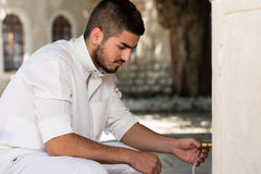 Islamic Religious Rite Ceremony Of Ablution Hand Washing Stock Photo