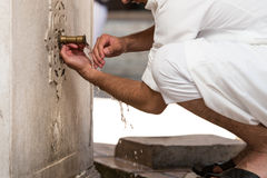 Islamic Religious Rite Ceremony Of Ablution Hand Washing Royalty Free Stock Photo