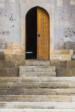 Islamic style half open doorway. Simple Islamic style half open doorway in Shirvanshah Palace, famous historical landmark of Baku, Azerbaijan Royalty Free Stock Image