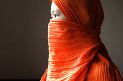 Islamic woman. Close-up of a islamic woman covered with a orange veil Royalty Free Stock Photography