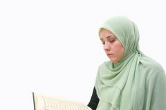 Islamic woman Koran Stock Images